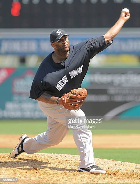 C Sabathia of the New York Yankees pitches against the Detroit Tigers during the spring training game at Joker Marchant Stadium on March 11 2009 in...