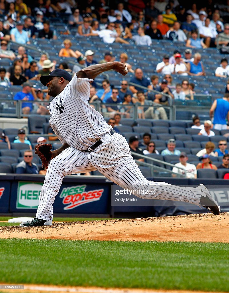 CC Sabathia # 52 of the New York Yankees pitches against the Minnesota Twins, Sabathia gave up eight runs and eight hits in four innings at Yankee Stadium on July 14, 2013 in the Bronx borough of New York City. The twins defeated the Yankees 10-4