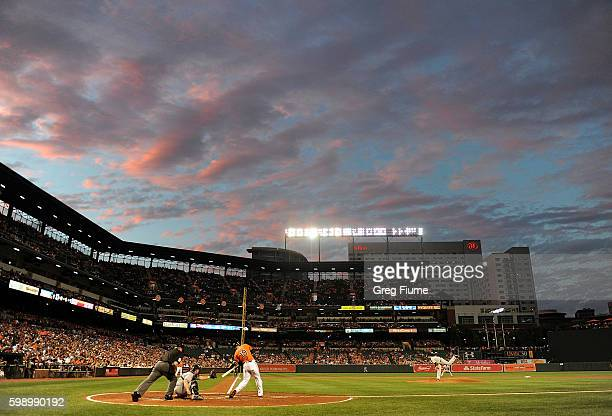 Sabathia of the New York Yankees pitches to Chris Davis of the Baltimore Orioles in the second inning at Oriole Park at Camden Yards on September 3...