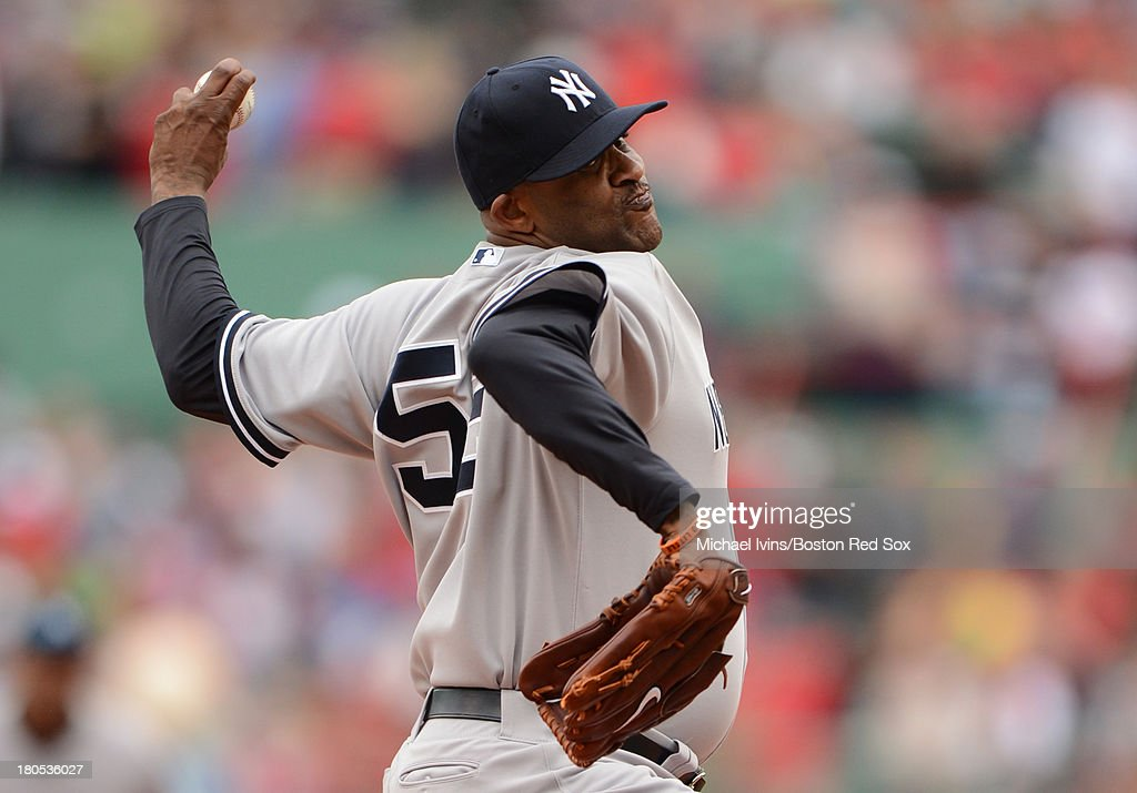 CC Sabathia #52 of the New York Yankees pithces against the Boston Red Sox in the first inning on September 14, 2013 at Fenway Park in Boston Massachusetts.