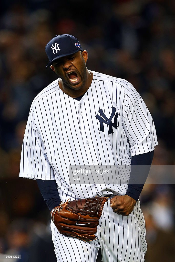 CC Sabathia #52 of the New York Yankees reacts after getting out of the eighth inning against the Baltimore Orioles during Game Five of the American League Division Series at Yankee Stadium on October 12, 2012 in New York, New York.