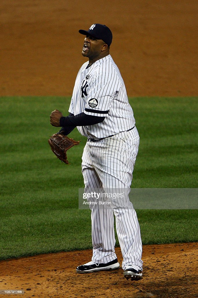 CC Sabathia #52 of the New York Yankees reacts after he struck out Mitch Moreland #18 of the Texas Rangers to end the top of the sixth inning of Game Five of the ALCS during the 2010 MLB Playoffs at Yankee Stadium on October 20, 2010 in the Bronx borough of New York City.