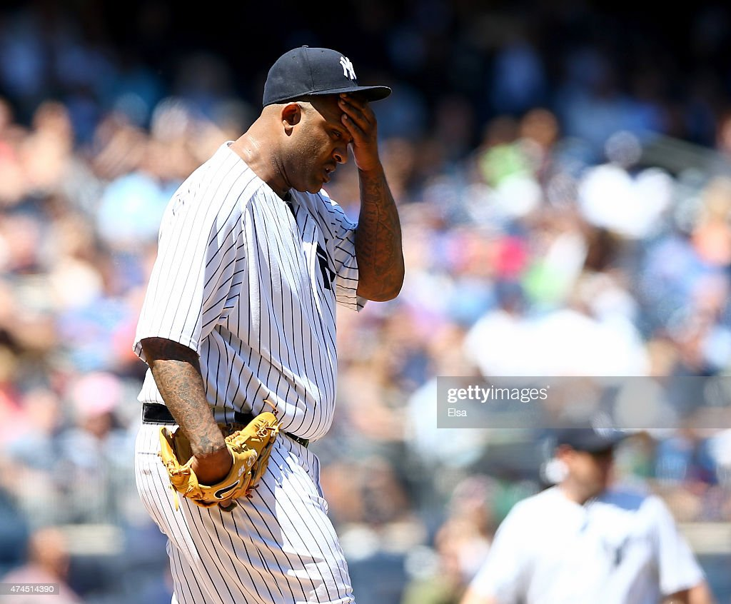 CC Sabathia #52 of the New York Yankees reacts in the third inning against the Texas Rangers on May 23, 2015 at Yankee Stadium in the Bronx borough of New York City.