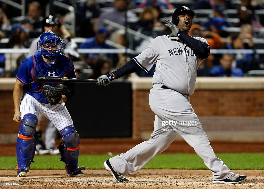 CC Sabathia #52 of the New York Yankees reacts to striking out during the fifth inning in front of Travis d'Arnaud #7 of the New York Mets at Citi Field on September 20, 2015 in the Queens borough of New York City.