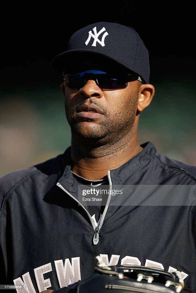 CC Sabathia #52 of the New York Yankees stands on the field during batting practice before their game against the Oakland Athletics at O.co Coliseum on June 12, 2013 in Oakland, California.