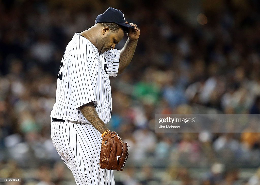 CC Sabathia #52 of the New York Yankees stands on the mound after throwing a wild pitch in the fifth inning against the Tampa Bay Rays at Yankee Stadium on September 14, 2012 in the Bronx borough of New York City.