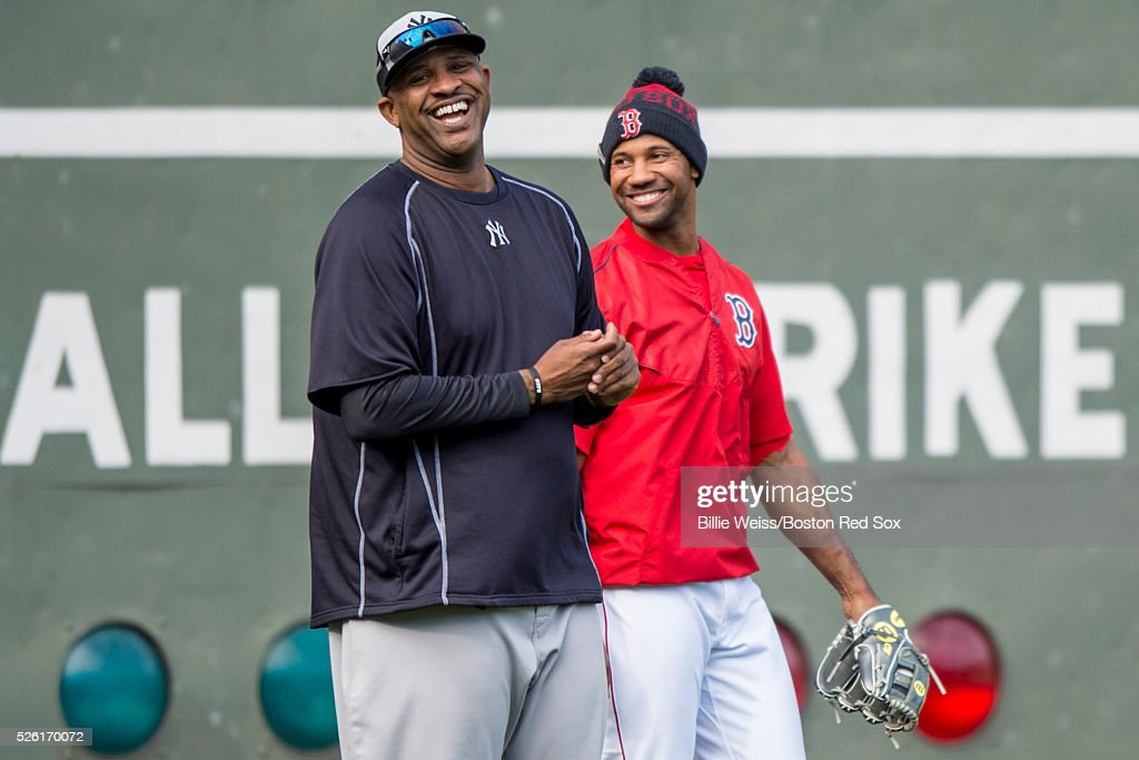 CC Sabathia #52 of the New York Yankees talks with Chris Young #30 of the Boston Red Sox before a game on April 29, 2016 at Fenway Park in Boston, Massachusetts .