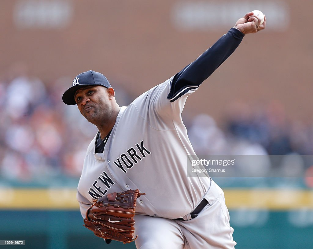 CC Sabathia #52 of the New York Yankees throws a first inning pitch while playing the Detroit Tigers at Comerica Park on April 7, 2013 in Detroit, Michigan.