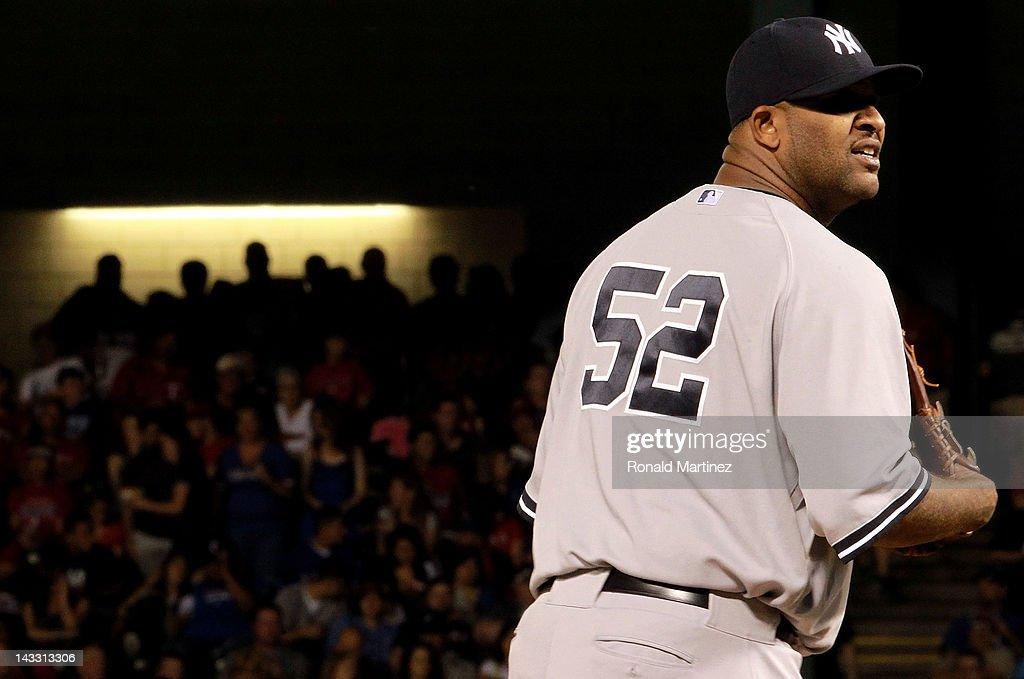 CC Sabathia #52 of the New York Yankees throws against the Texas Rangers at Rangers Ballpark in Arlington on April 23, 2012 in Arlington, Texas.