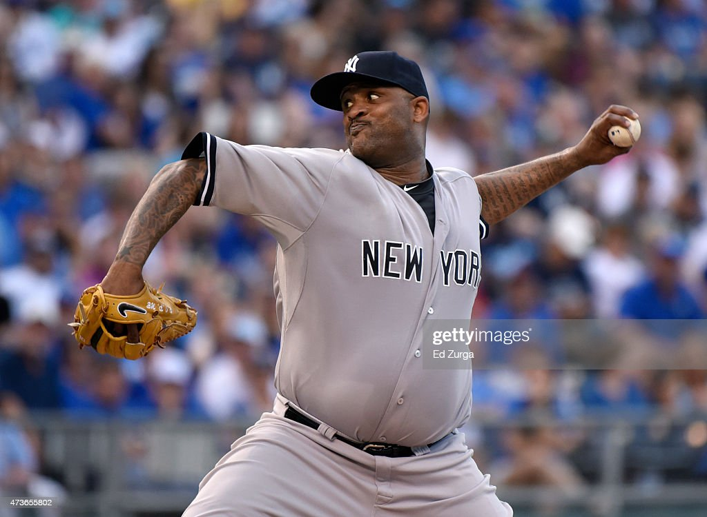 CC Sabathia #52 of the New York Yankees throws in the first inning against the Kansas City Royals at Kauffman Stadium on May 16, 2014 in Kansas City, Missouri.