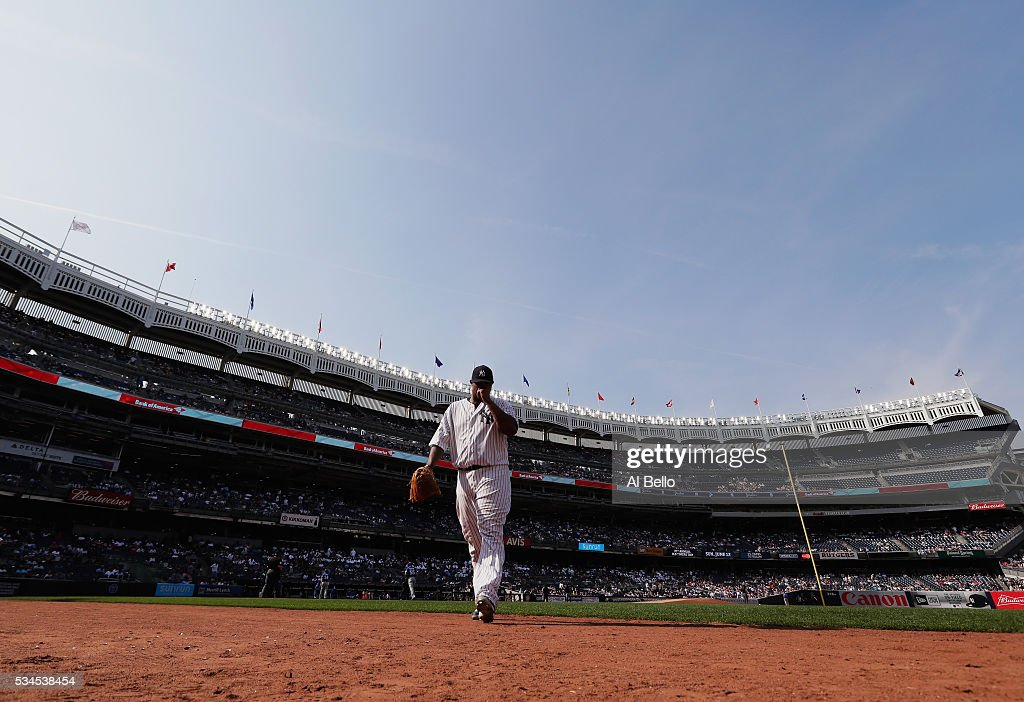 CC Sabathia #52 of the New York Yankees walks back to the dugout against the Toronto Blue Jays during their game at Yankee Stadium on May 26, 2016 in New York City.