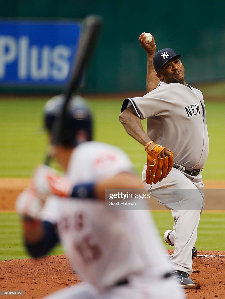 C.C. Sabathia #52 of the the New York Yankees throws a pitch in the first inning to Jason Castro #15 of the Houston Astros during the game at Minute Maid Park on April 1, 2014 in Houston, Texas.