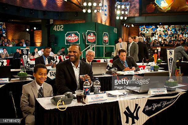 Sabathia sits at the New York Yankees table with his son during the 2012 FirstYear Player Draft Monday June 4 at MLB Network's Studio 42 in Secaucus...