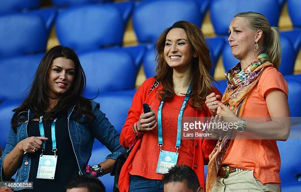 Sabia Boulahrouz and Bouchra van Persie are pictured prior to the UEFA EURO 2012 group B match between Portugal and Netherlands at Metalist Stadium...