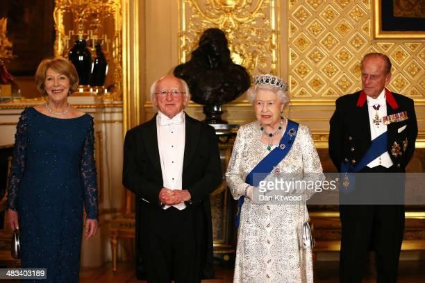 Sabina Coyne President of Ireland Michael D Higgins Queen Elizabeth II and Prince Philip Duke of Edinburgh pose for a photograph ahead of a State...