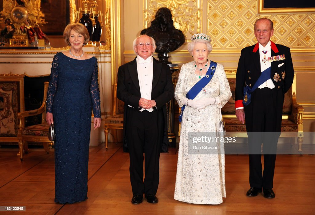 Sabina Coyne, President of Ireland <a gi-track='captionPersonalityLinkClicked' href=/galleries/search?phrase=Michael+D.+Higgins&family=editorial&specificpeople=7493414 ng-click='$event.stopPropagation()'>Michael D. Higgins</a>, Queen <a gi-track='captionPersonalityLinkClicked' href=/galleries/search?phrase=Elizabeth+II&family=editorial&specificpeople=67226 ng-click='$event.stopPropagation()'>Elizabeth II</a> and <a gi-track='captionPersonalityLinkClicked' href=/galleries/search?phrase=Prince+Philip&family=editorial&specificpeople=92394 ng-click='$event.stopPropagation()'>Prince Philip</a>, Duke of Edinburgh pose for a photograph ahead of a State Banquet on April 8, 2014 in Windsor, England. Guests and dignitaries including Irish prime minister, Enda Kenny and Northern Ireland's deputy first minister Martin McGuinness attending the banquet at the end of the first day of a state visit by Ireland's <a gi-track='captionPersonalityLinkClicked' href=/galleries/search?phrase=Michael+D.+Higgins&family=editorial&specificpeople=7493414 ng-click='$event.stopPropagation()'>Michael D. Higgins</a>. Ireland's <a gi-track='captionPersonalityLinkClicked' href=/galleries/search?phrase=Michael+D.+Higgins&family=editorial&specificpeople=7493414 ng-click='$event.stopPropagation()'>Michael D. Higgins</a> is making the first state visit by a president of the republic since it gained independence from neighbouring Britain. The visit comes three years after Queen <a gi-track='captionPersonalityLinkClicked' href=/galleries/search?phrase=Elizabeth+II&family=editorial&specificpeople=67226 ng-click='$event.stopPropagation()'>Elizabeth II</a> made a groundbreaking trip to the republic, which helped to heal deep-rooted unease and put British-Irish relations on a new footing. Higgins' return visit will be seen as an official sign of further progress following the hard-won peace in Northern Ireland, which remains part of the United Kingdom.
