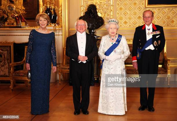 Sabina Coyne President of Ireland Michael D Higgins Queen Elizabeth II and Prince Philip Duke of Edinburgh pose for a photograph ahead of a State...