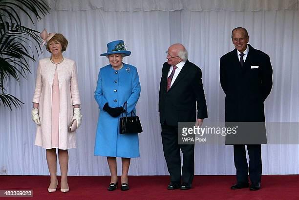 Sabina Coyne Queen Elizabeth II the President of Ireland Michael D Higgins and Prince Philip Duke of Edinburgh inspect the guard at Windsor Castle on...