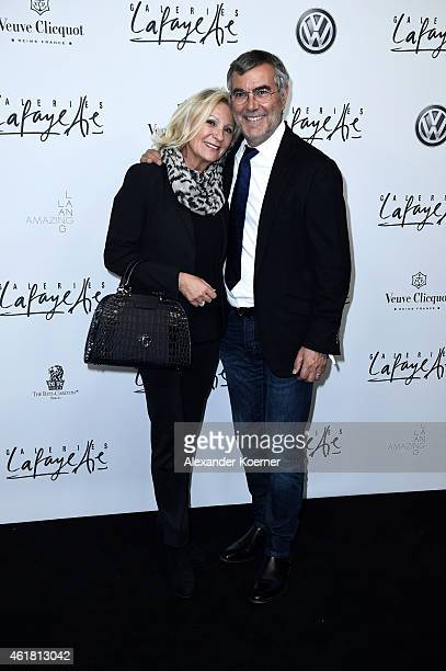 Sabine Christiansen and Norbert Medus attend the 'Amazing Lang Lang' World Premiere Fragrance Launch at Galeries Lafayette on January 19 2015 in...
