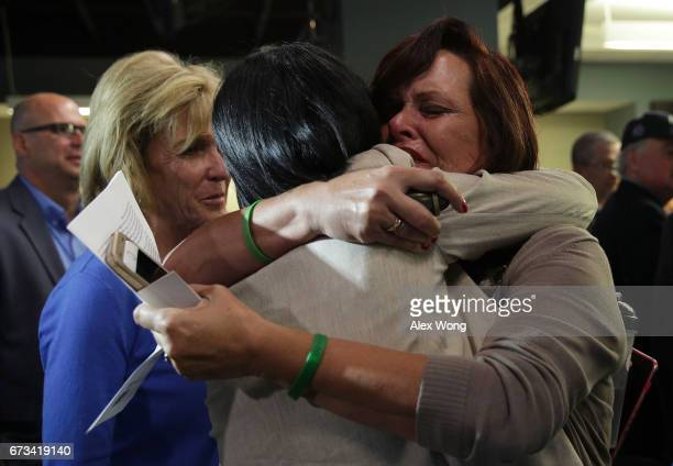 Sabine Durden of Mineral Spring Arkansas whose son Dominic Durden was killed in a traffic accident with an undocumented immigrant receives a hug from...