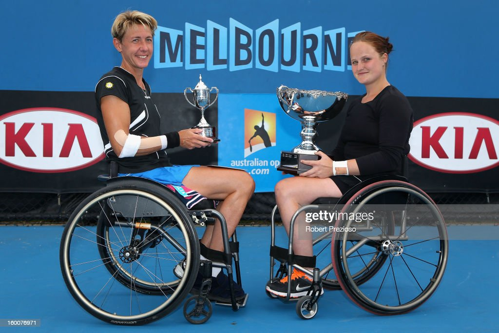 Sabine Ellerbrock of Germany poses with the runners-up trophy alongside championship winner Aniek Van Koot of the Netherlands after their Women's Wheelchair Singles Final match during the 2013 Australian Open Wheelchair Championships at Melbourne Park on January 26, 2013 in Melbourne, Australia.