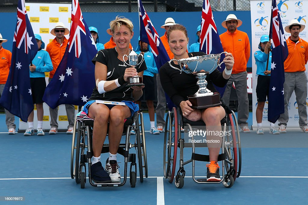 Sabine Ellerbrock of Germany poses with the runners-up trophy alongside championship winner <a gi-track='captionPersonalityLinkClicked' href=/galleries/search?phrase=Aniek+Van+Koot&family=editorial&specificpeople=5901217 ng-click='$event.stopPropagation()'>Aniek Van Koot</a> of the Netherlands after their Women's Wheelchair Singles Final match during the 2013 Australian Open Wheelchair Championships at Melbourne Park on January 26, 2013 in Melbourne, Australia.