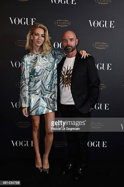 Sabine Getty and a guest attend the Vogue 95th Anniversary Party on October 3 2015 in Paris France