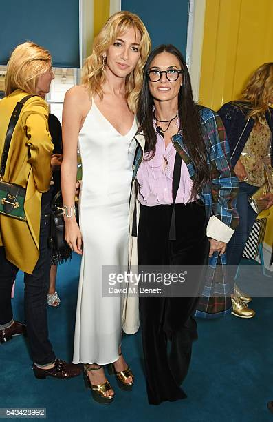Sabine Getty and Demi Moore attend a drinks reception and dinner in celebration of the Sabine Getty Showroom in Berkeley Square on June 28 2016 in...