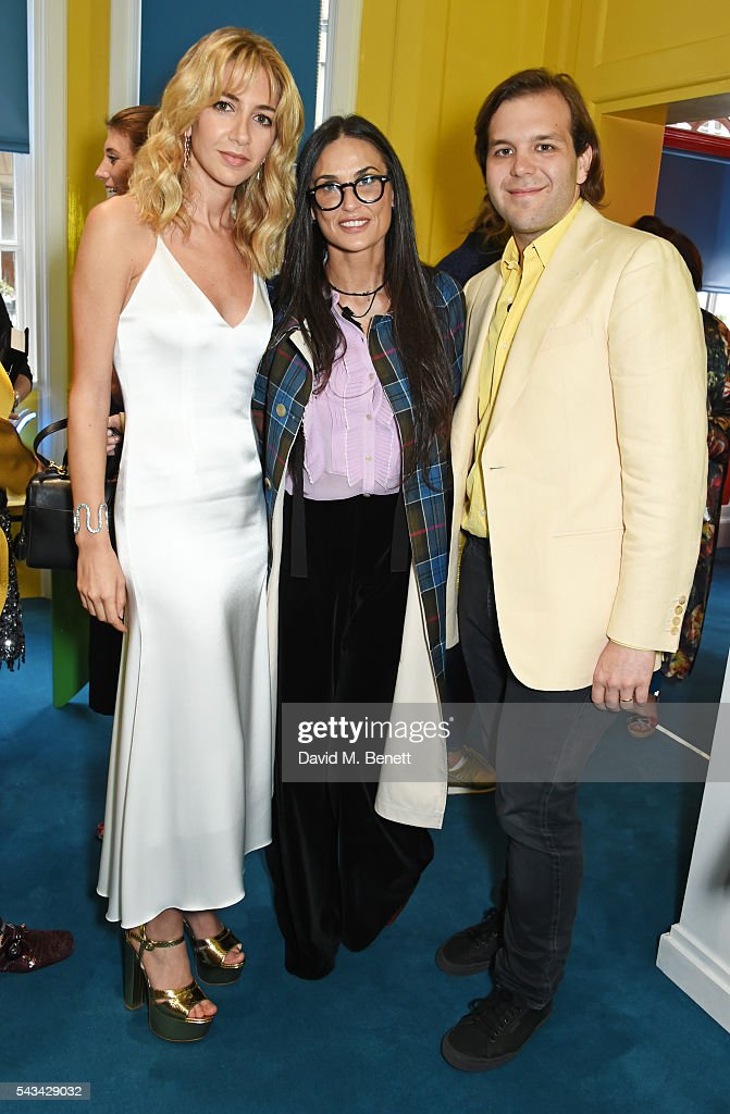 Sabine Getty, <a gi-track='captionPersonalityLinkClicked' href=/galleries/search?phrase=Demi+Moore&family=editorial&specificpeople=202121 ng-click='$event.stopPropagation()'>Demi Moore</a> and Joseph Getty attend a drinks reception and dinner in celebration of the Sabine Getty Showroom in Berkeley Square on June 28, 2016 in London, England.
