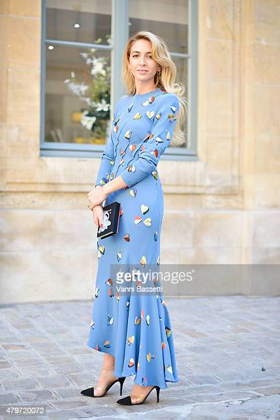 Sabine Getty poses wearing a Schiapparelli dress and an Olympia Le Tan clutch before the Schiapparelli show at Place Vendome on July 6 2015 in Paris...
