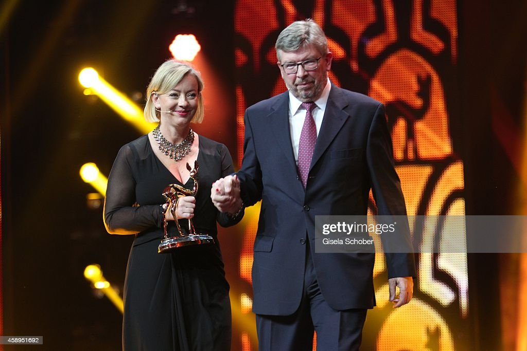 Sabine Kehm and Ross Brawn accept the millennium award on behalf of Michael Schumacher during the Bambi Awards 2014 show on November 13 2014 in...