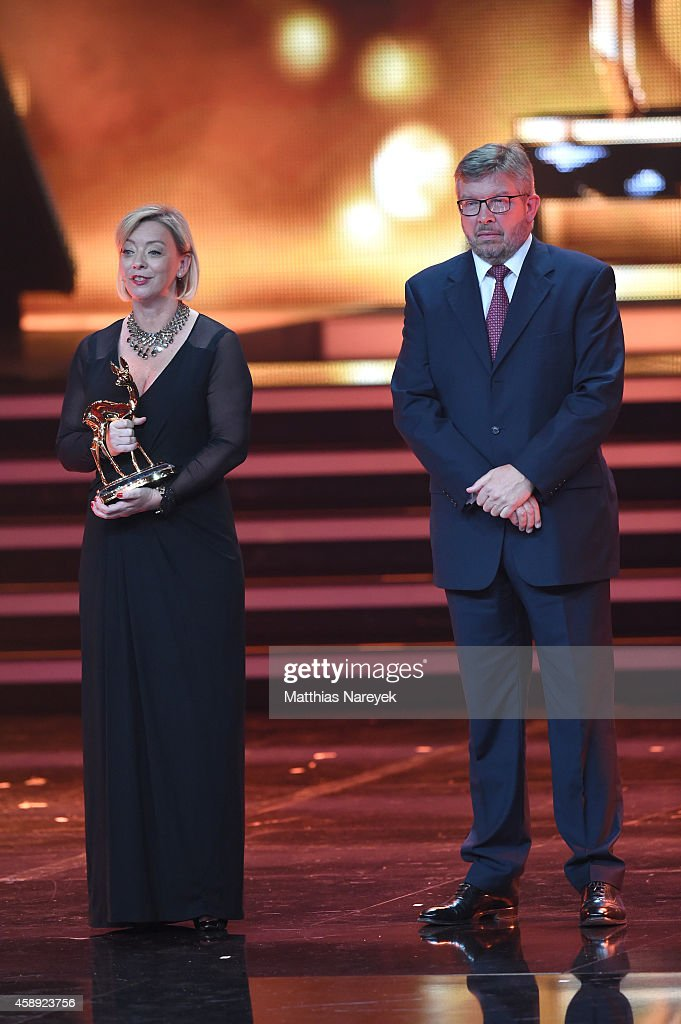 Sabine Kehm managerin of Michael Schumacher accepts the award on behalf of Michael Schumacher next to Formula 1 personality Ross Brawn during the...