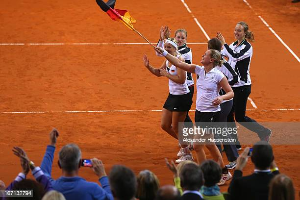 Sabine Lisicki Angelique Kerber AnnaLena Groenefeld Julia Goerges and Mona Barthel of team Germany celebrate victory after winning the double match...