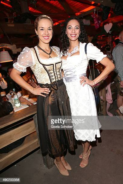 Sabine Lisicki Lilly Becker wearing a Claudia Effenberg dirndl during the Oktoberfest 2015 at Kaeferschaenke at Theresienwiese on September 26 2015...