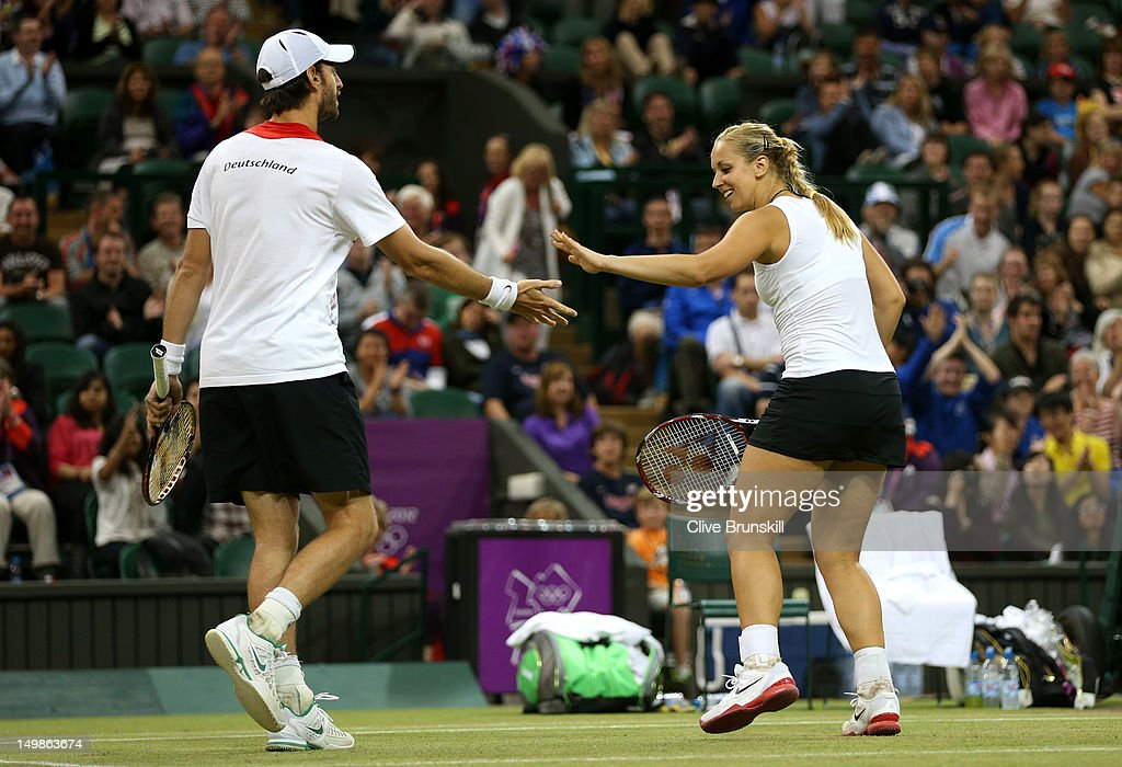 Sabine Lisicki of Germany and Christopher Kas of Germany celebrate a point during the Mixed Doubles Tennis bronze medal match against as Lisa Raymond...