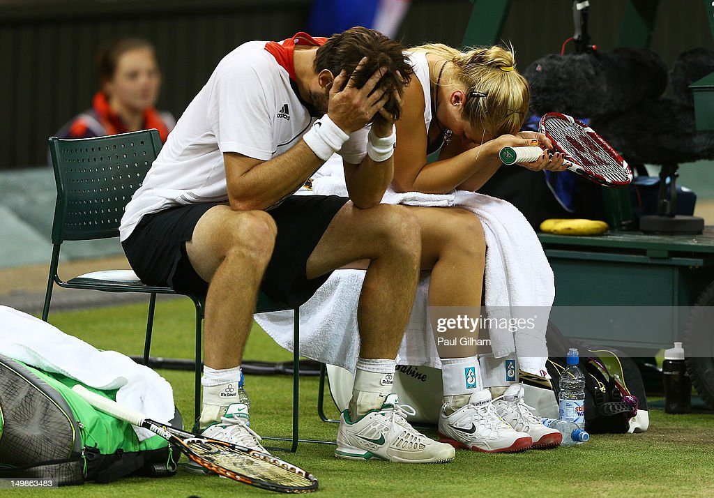 <a gi-track='captionPersonalityLinkClicked' href=/galleries/search?phrase=Sabine+Lisicki&family=editorial&specificpeople=645395 ng-click='$event.stopPropagation()'>Sabine Lisicki</a> of Germany and <a gi-track='captionPersonalityLinkClicked' href=/galleries/search?phrase=Christopher+Kas&family=editorial&specificpeople=987913 ng-click='$event.stopPropagation()'>Christopher Kas</a> of Germany show their dejection after the Mixed Doubles Tennis bronze medal match against as Lisa Raymond of the United States and Mike Bryan of the United States on Day 9 of the London 2012 Olympic Games at the All England Lawn Tennis and Croquet Club on August 5, 2012 in London, England.