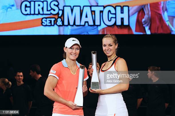 Sabine Lisicki of Germany and Samantha Stosur of Australia pose after winning their Doubles Final match against Kristina Barrois and Jasmin Woehr of...