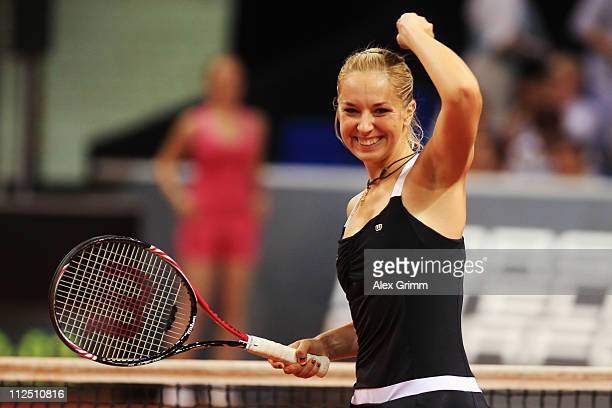 Sabine Lisicki of Germany celebrates after winning her first round match against Dominika Cibulkova of Slovakia at the Porsche Tennis Grand Prix at...