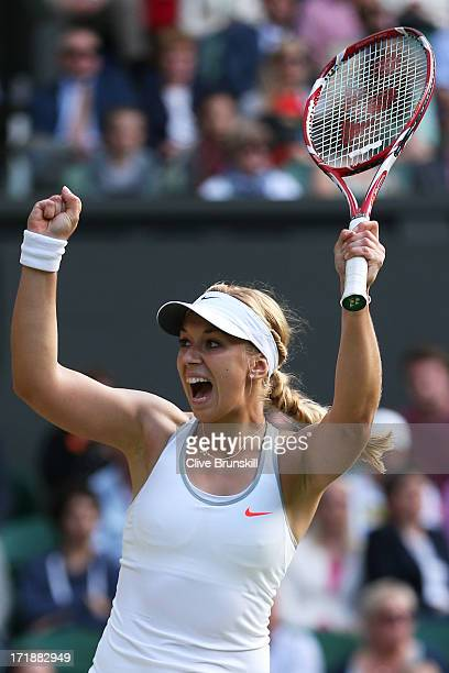 Sabine Lisicki of Germany celebrates match point during the Ladies' Singles third round match against Samantha Stosur of Australia on day six of the...