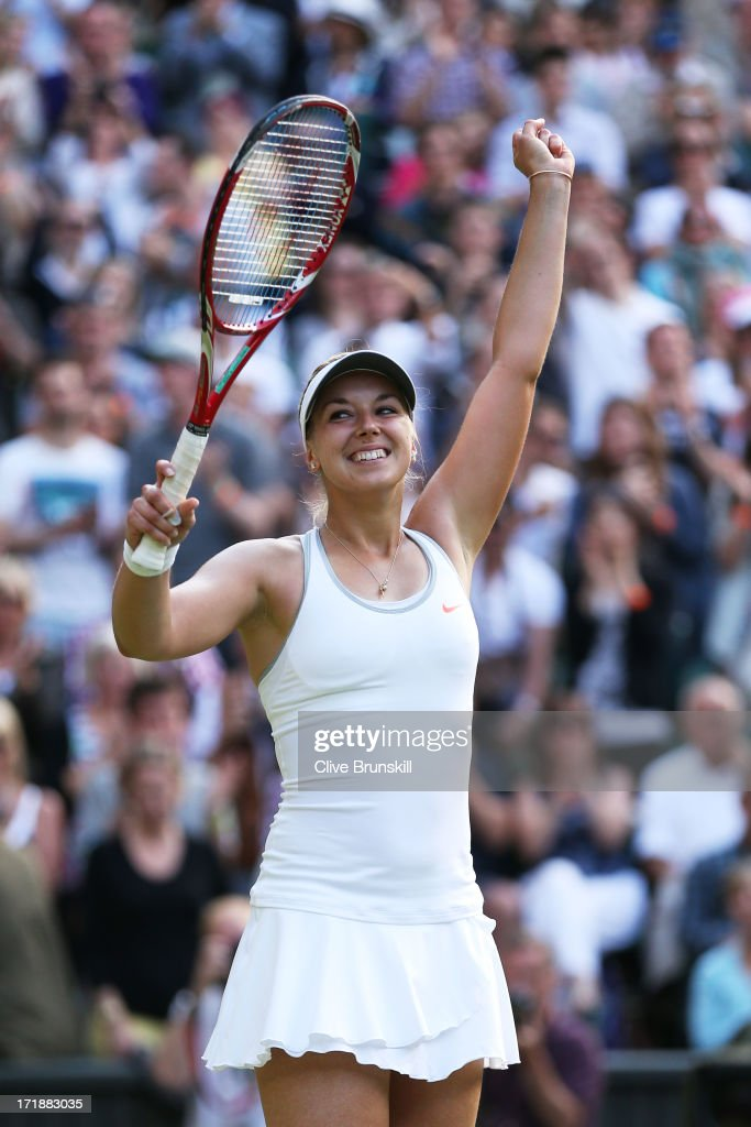 <a gi-track='captionPersonalityLinkClicked' href=/galleries/search?phrase=Sabine+Lisicki&family=editorial&specificpeople=645395 ng-click='$event.stopPropagation()'>Sabine Lisicki</a> of Germany celebrates match point during the Ladies' Singles third round match against Samantha Stosur of Australia on day six of the Wimbledon Lawn Tennis Championships at the All England Lawn Tennis and Croquet Club on June 29, 2013 in London, England.