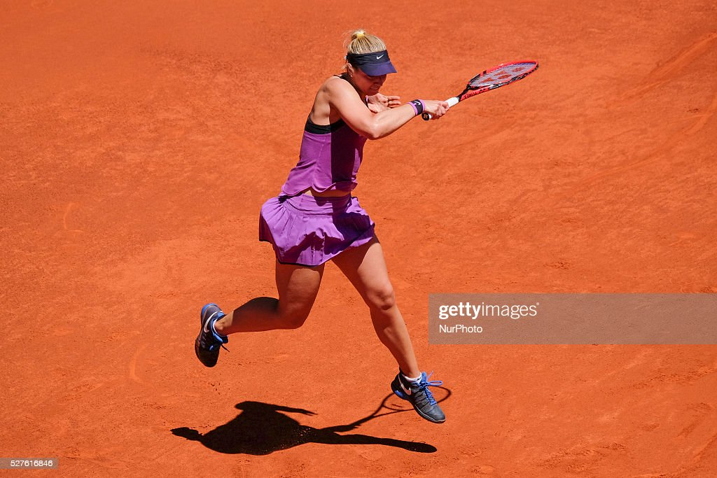 Sabine Lisicki of Germany in action Carla Suarez of Spain their match during day fourth of the Mutua Madrid Open tennis tournament at the Caja Magica on May 03 2016 in Madrid,Spain.