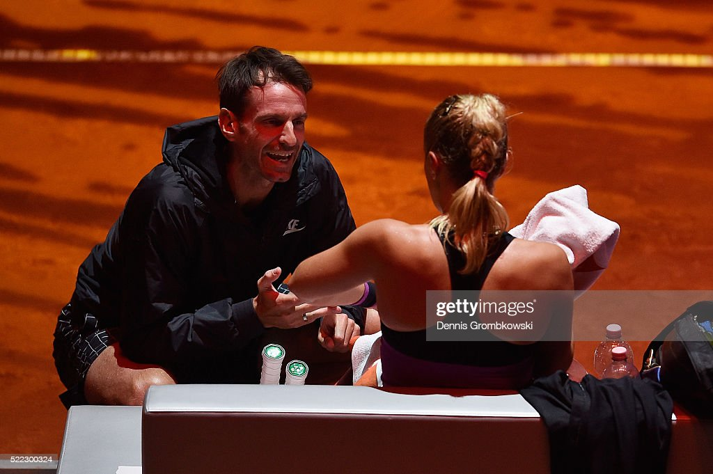 Sabine Lisicki of Germany is instructed by her coach Christopher Kas during her match against Timea Babos of Hungary during Day 1 of the Porsche...