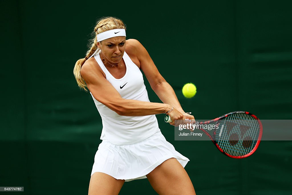 <a gi-track='captionPersonalityLinkClicked' href=/galleries/search?phrase=Sabine+Lisicki&family=editorial&specificpeople=645395 ng-click='$event.stopPropagation()'>Sabine Lisicki</a> of Germany plays a back hand during the Ladies Singles second round match agaist Samantha Stosur of Australia on day four of the Wimbledon Lawn Tennis Championships at the All England Lawn Tennis and Croquet Club on June 30, 2016 in London, England.