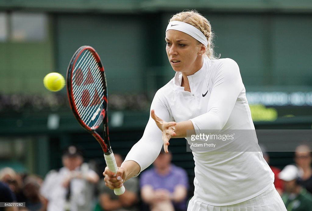 <a gi-track='captionPersonalityLinkClicked' href=/galleries/search?phrase=Sabine+Lisicki&family=editorial&specificpeople=645395 ng-click='$event.stopPropagation()'>Sabine Lisicki</a> of Germany plays a back hand shot during the Ladies Singles first round match against Shelby Rogers of The United States on day one of the Wimbledon Lawn Tennis Championships at the All England Lawn Tennis and Croquet Club on June 27th, 2016 in London, England.
