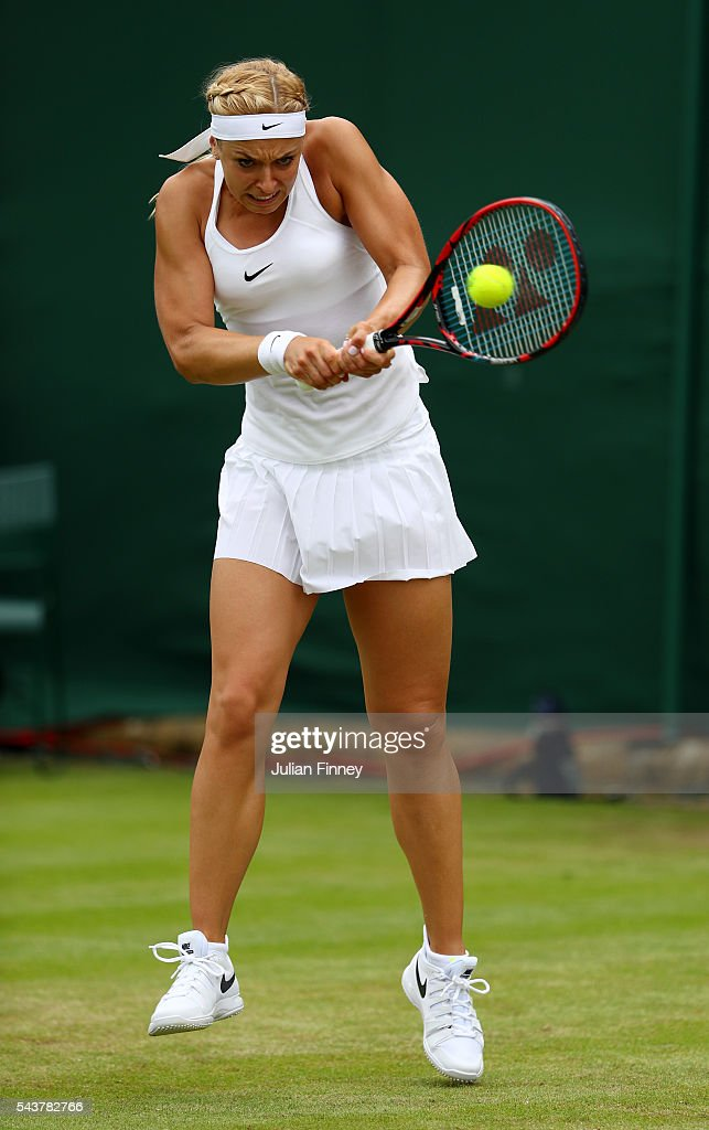 <a gi-track='captionPersonalityLinkClicked' href=/galleries/search?phrase=Sabine+Lisicki&family=editorial&specificpeople=645395 ng-click='$event.stopPropagation()'>Sabine Lisicki</a> of Germany plays a backhand during the Ladies Singles second round match agaist Samantha Stosur of Australia on day four of the Wimbledon Lawn Tennis Championships at the All England Lawn Tennis and Croquet Club on June 30, 2016 in London, England.