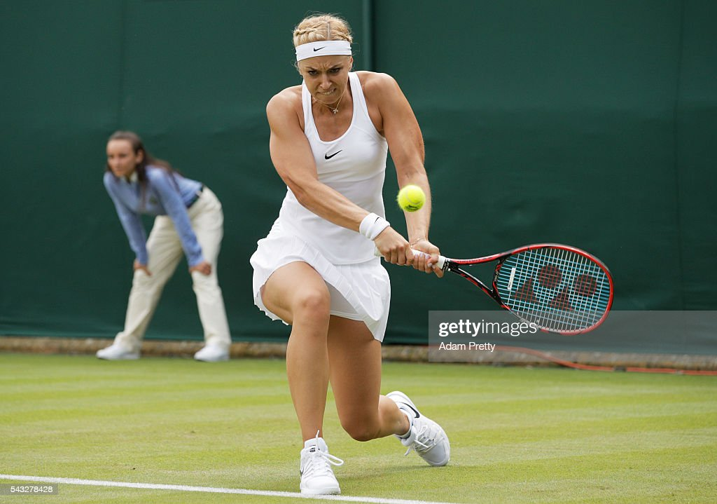 <a gi-track='captionPersonalityLinkClicked' href=/galleries/search?phrase=Sabine+Lisicki&family=editorial&specificpeople=645395 ng-click='$event.stopPropagation()'>Sabine Lisicki</a> of Germany plays a backhand shot during the Ladies Singles first round match against Shelby Rogers of The United States on day one of the Wimbledon Lawn Tennis Championships at the All England Lawn Tennis and Croquet Club on June 27th, 2016 in London, England.