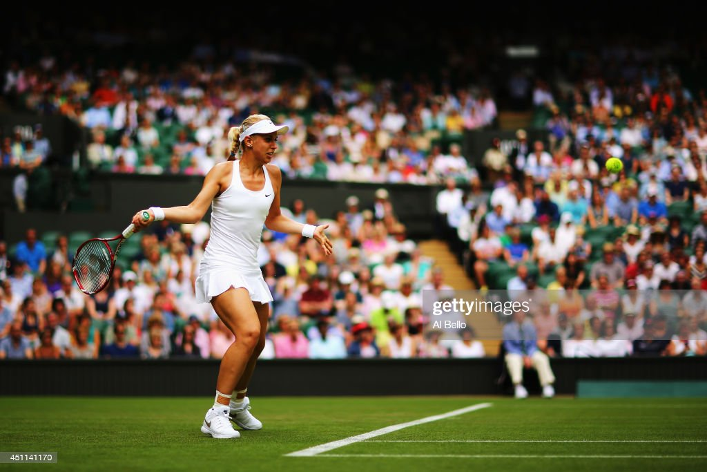 Sabine Lisicki of Germany plays a forehand during her Ladies' Singles first round match against against Julia Glushko of Israel on day two of the Wimbledon Lawn Tennis Championships at the All England Lawn Tennis and Croquet Club at Wimbledon on June 24, 2014 in London, England.