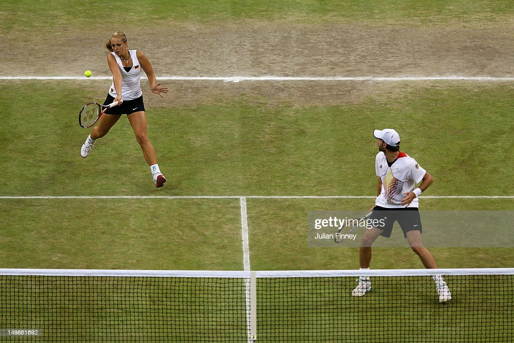 Sabine Lisicki of Germany plays a forehand next to Christopher Kas of Germany during the Mixed Doubles Tennis bronze medal match against as Lisa...