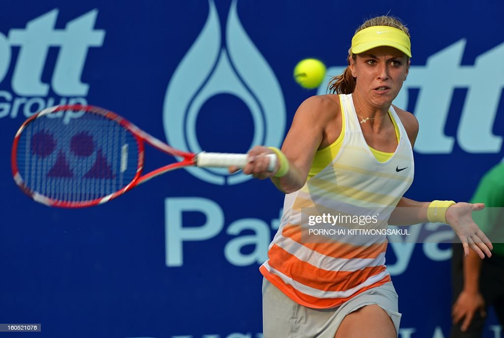 Sabine Lisicki of Germany plays a shot against Nina Bratchikova of Russia during the tennis women's singles semi-final round of the WTA Pattaya Open tennis tournament in Pattaya on February 2, 2013.