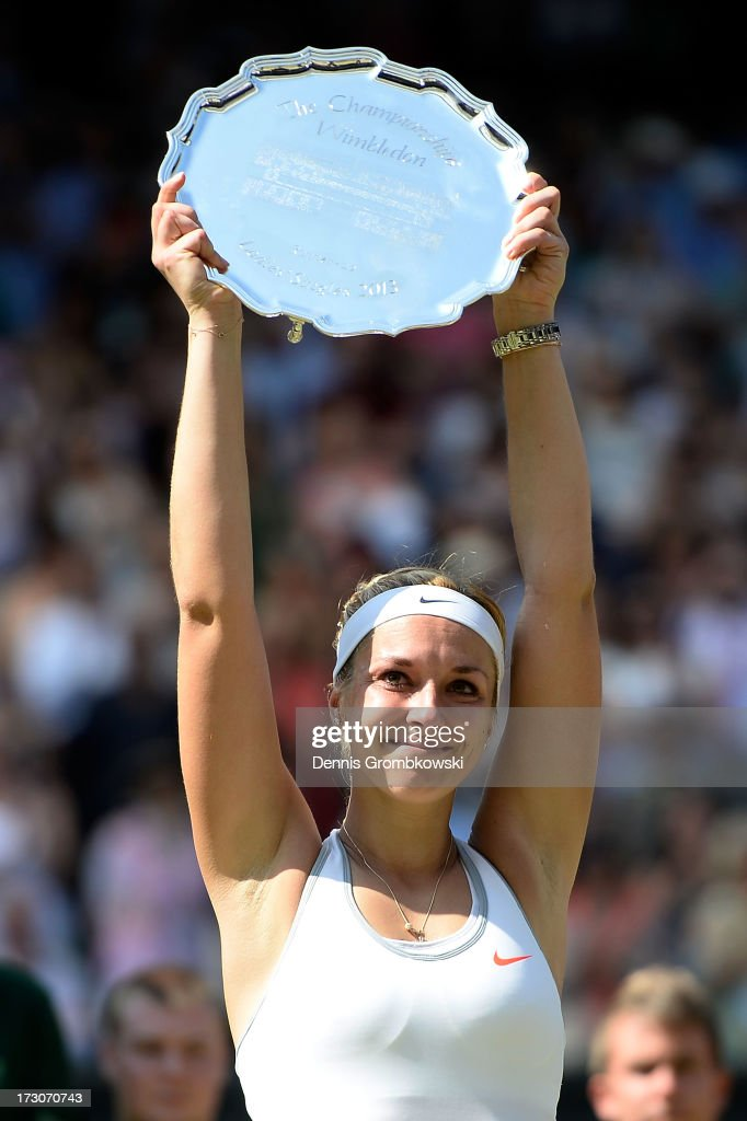 <a gi-track='captionPersonalityLinkClicked' href=/galleries/search?phrase=Sabine+Lisicki&family=editorial&specificpeople=645395 ng-click='$event.stopPropagation()'>Sabine Lisicki</a> of Germany poses with her runner-up trophy on Centre Court after her Ladies' Singles final match against Marion Bartoli of France on day twelve of the Wimbledon Lawn Tennis Championships at the All England Lawn Tennis and Croquet Club on July 6, 2013 in London, England.